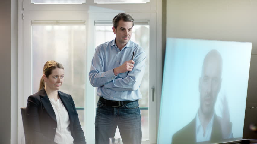 Business people looking at screen in a video conference | Shutterstock HD Video #15683881