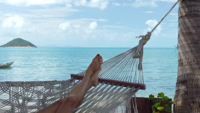 Woman in hammock on the beach | Shutterstock HD Video #15728332