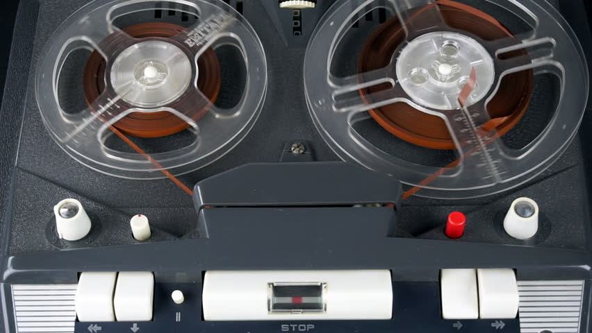 1960s four track tape recorder stopping, rewind, play and stop. With professionally recorded sound.