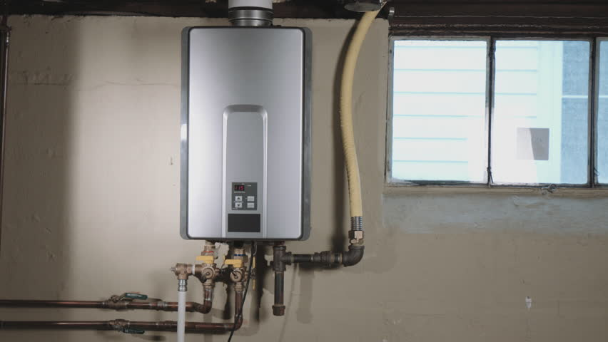 Reveal Tankless Water Heater From Behind Wall. Camera Moves Left From  Behind A Wall To