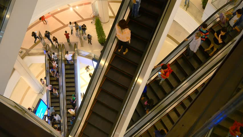 Escalator 4k shopping mall crowd of people buy shop center centre last minute sales christmas shopping frenzy big indoors complex | Shutterstock HD Video #15847618