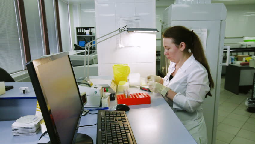 A Woman Chemist Or Laboratory Technician Enters The Scene Where A – Lab Chemist