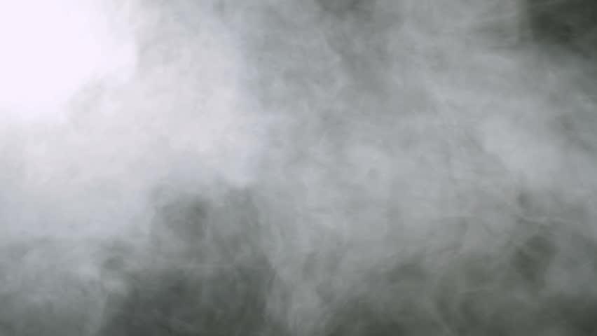 Smoke background. Abstract smoke cloud. Smoke in slow motion on black background. White smoke slowly floating through space against black background. Smoke effect. Fog effect. Smoke machine
