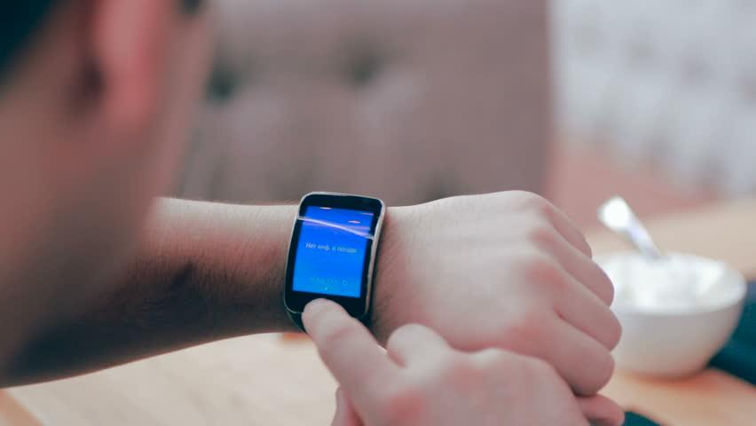 Smartwatch on a mans hand.   Shutterstock HD Video #16071319