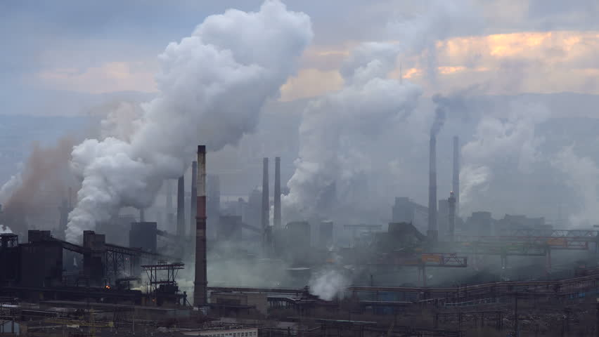 Air Pollution From Industrial Plants. Large Plant on the Background of the City. Pipes Throwing Smoke in the Sky