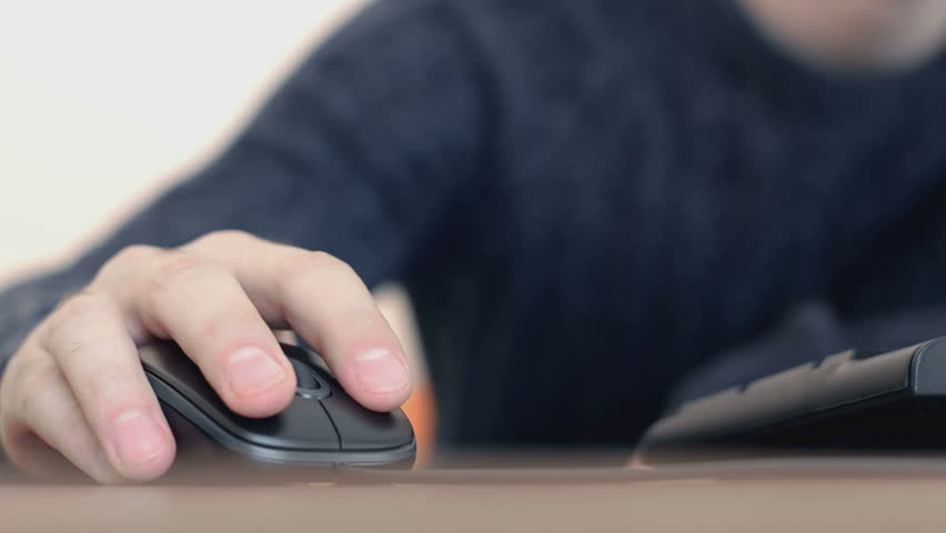 Hand of a man working at computer clicking on mouse typing text on keyboard | Shutterstock HD Video #16269874