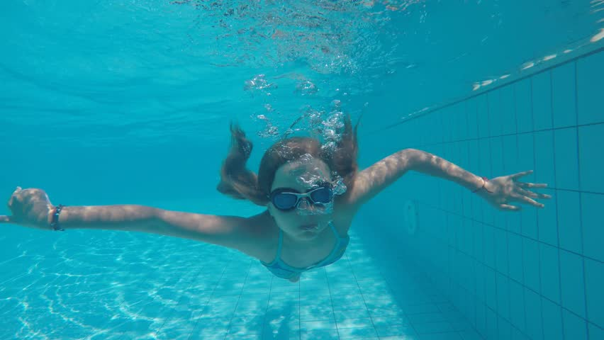 Underwater Scene With Young Lady Finning Over Sandy Bottom In A Tropical Sea Stock Footage Video