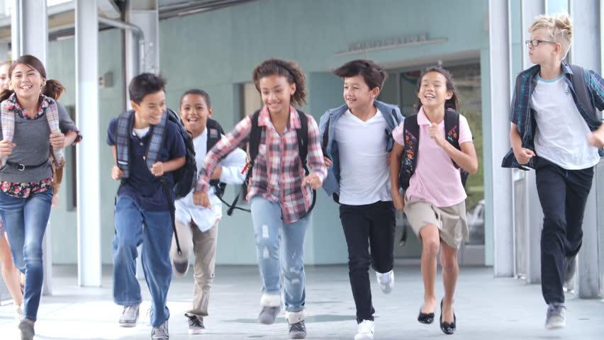 Group of 5th grade school kids running in a school corridor   Shutterstock HD Video #16356877