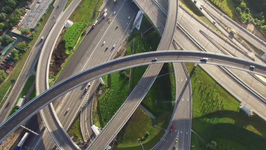 Unique flyover the complex road junction. Sunny day, sunset. Modern Russia. Moscow aerial high altitude drone flight. Ultrahd 4K.