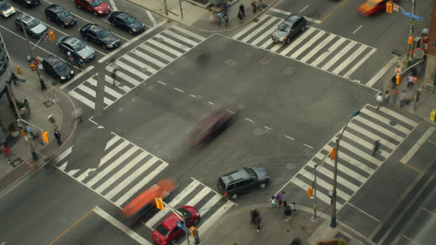 Intersection of Front and Simcoe in downtown Toronto with vehicles and