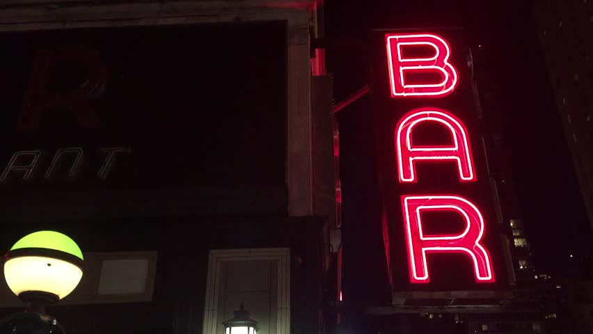 New York City Nighttime NX Establishing Shot CV of Bar Pub. Night exterior video footage of vintage neon sign. New York people go out at night to have fun, drink alcohol, go out on date, get together | Shutterstock HD Video #16444246