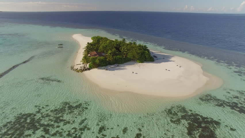 Aerial shot of a small tropical island in Maldives island, 2015. Palm tree on the sandbank. | Shutterstock HD Video #16501024
