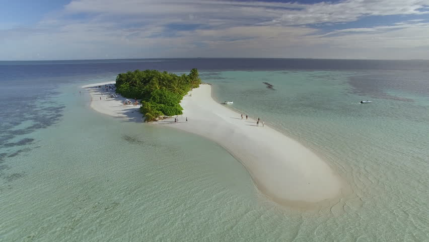 Flight over of a small tropical island in Maldives island, 2015. Palm trees on the sandbank. | Shutterstock HD Video #16501036