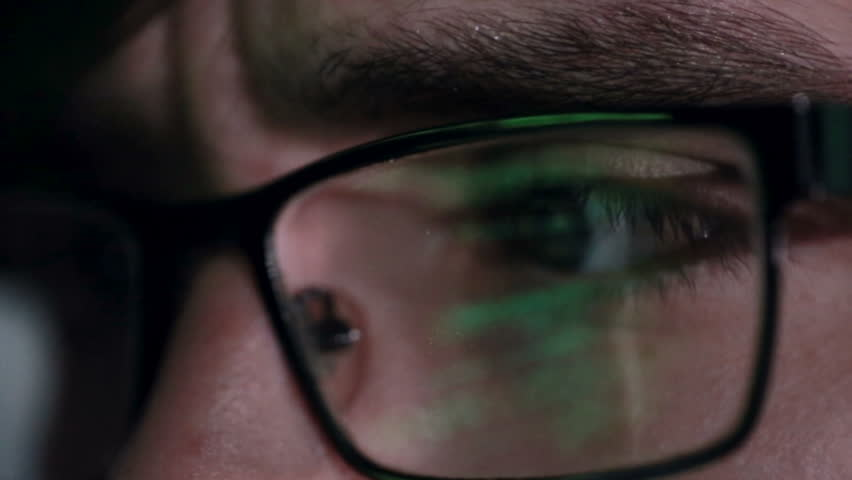 Data code Reflection in Programmers, hackers Glasses. | Shutterstock HD Video #16528159