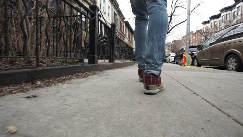 An unrecognizable man walks through New York...