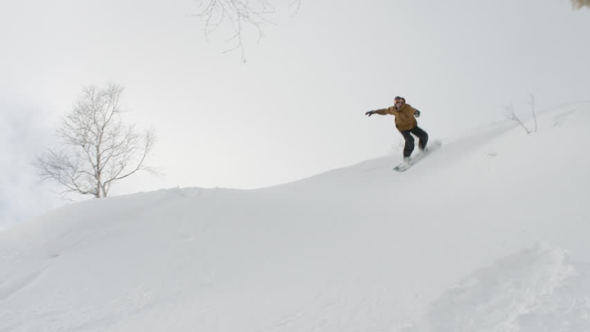 Snowboarder Does a Backflip then Crashes in the Snow With a Frontflip in a Funny Moment While Freestyle Snowboarding