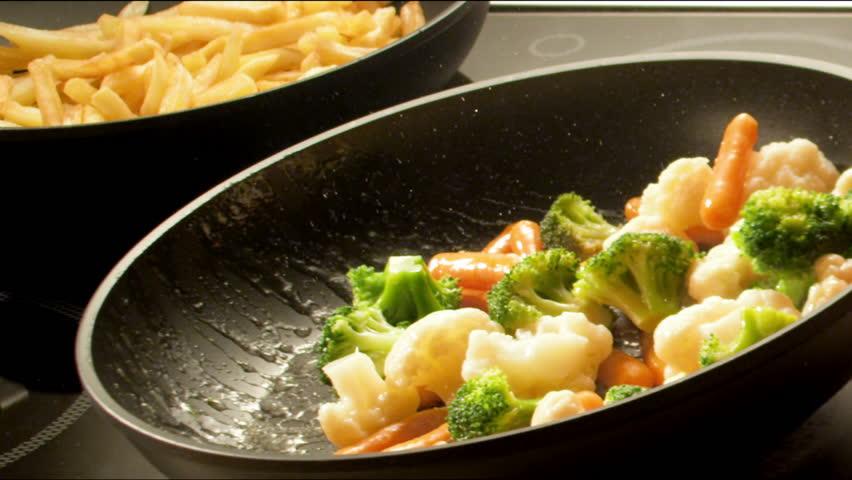 Frying vegetables | Shutterstock Video #1670074