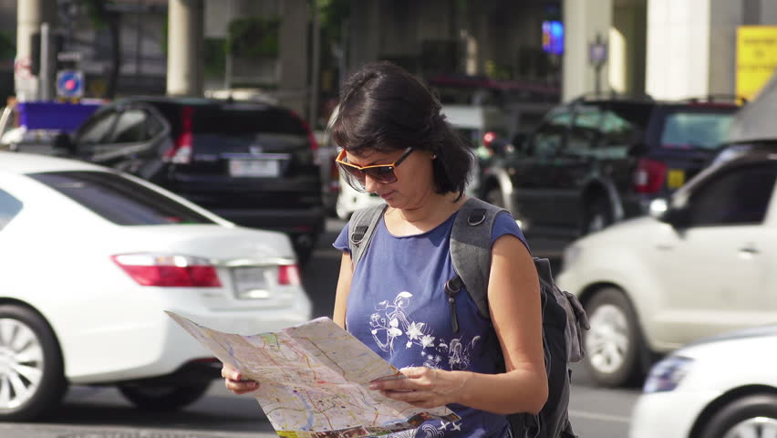 Attractive Woman Reading Tourist Map On City Street Full Hd Stock Footage Clip