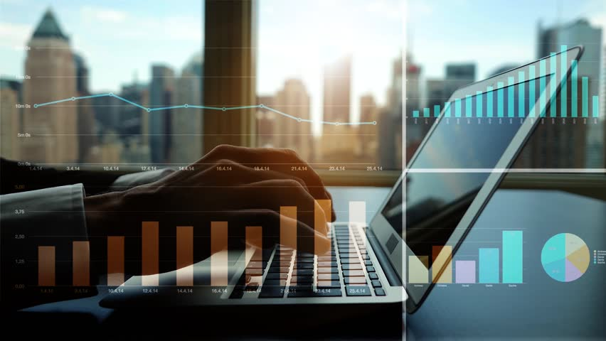Working on laptop computer in modern office desk analyzing financial  profits progress. business charts diagrams background. online banking from home. city skyline window view    Shutterstock HD Video #16830703