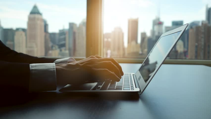 Working on laptop computer in modern office desk analyzing financial  profits progress. business charts diagrams background. online banking from home. city skyline window view    Shutterstock HD Video #16830721