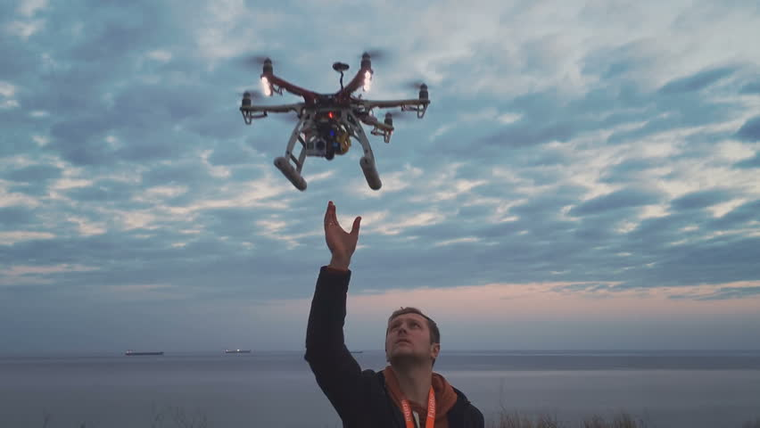 Hexacopter drone lands on your hands | Shutterstock HD Video #16895509
