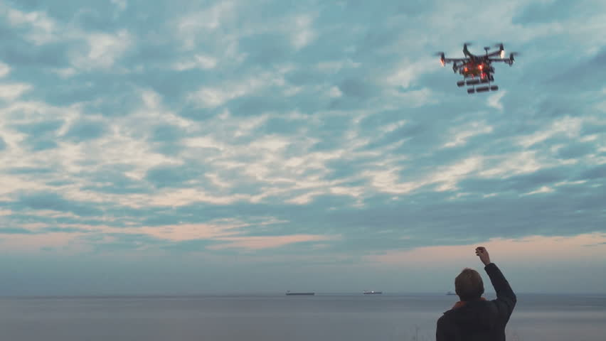 Custom drone hexacopter lands on your hands | Shutterstock HD Video #16895512