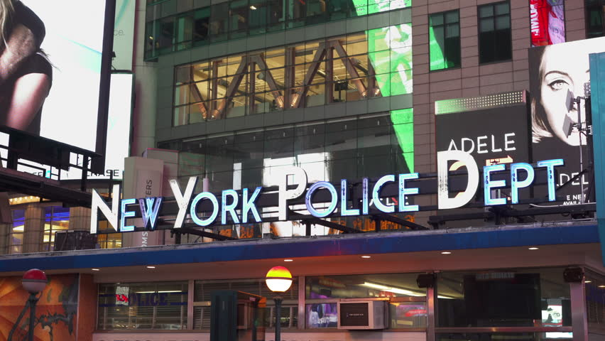 NEW YORK CITY, NY - NOVEMBER 26 : New York Police department in downtown Times Square with ads and commercial billboards on November 26, 2015 in New York City, New York.