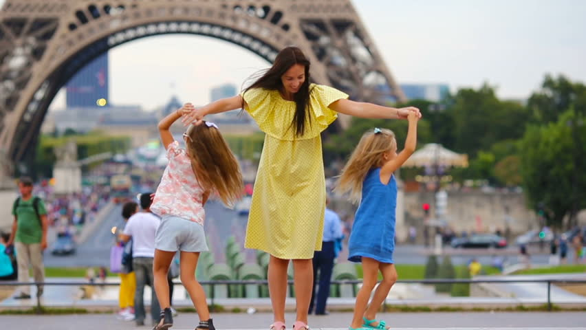 Happy family in Paris near Eiffel tower. French summer holidays, travel and people concept.   Shutterstock HD Video #17026528