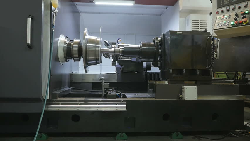 Metal Spinning machine shaping a peace of metal | Shutterstock HD Video #17051218