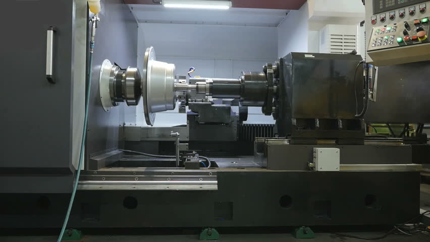 Metal Spinning machine shaping a peace of metal | Shutterstock HD Video #17051236