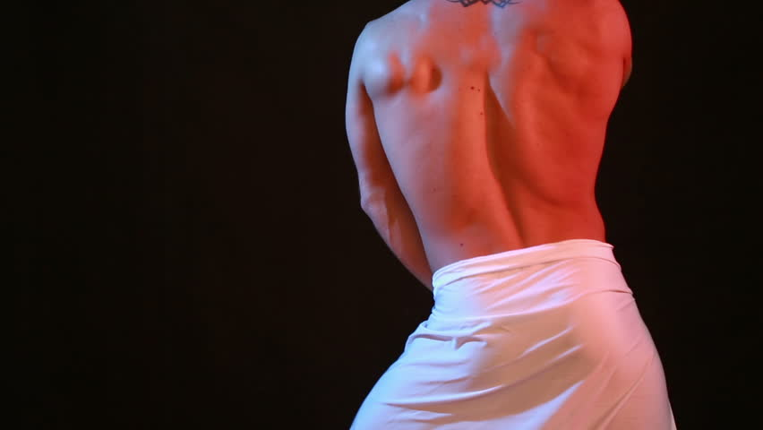 Muscular young sexy naked cute man. male striptease dancing.