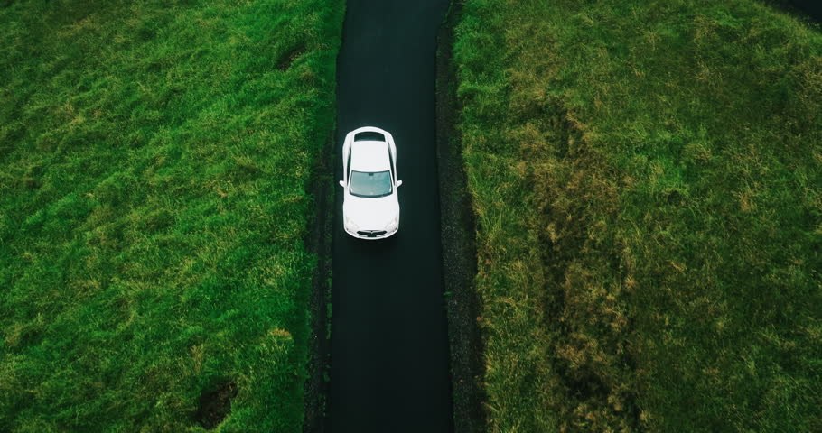 Aerial view electric car driving on country road, luxury car driving through mist at dusk with headlights | Shutterstock HD Video #17354455