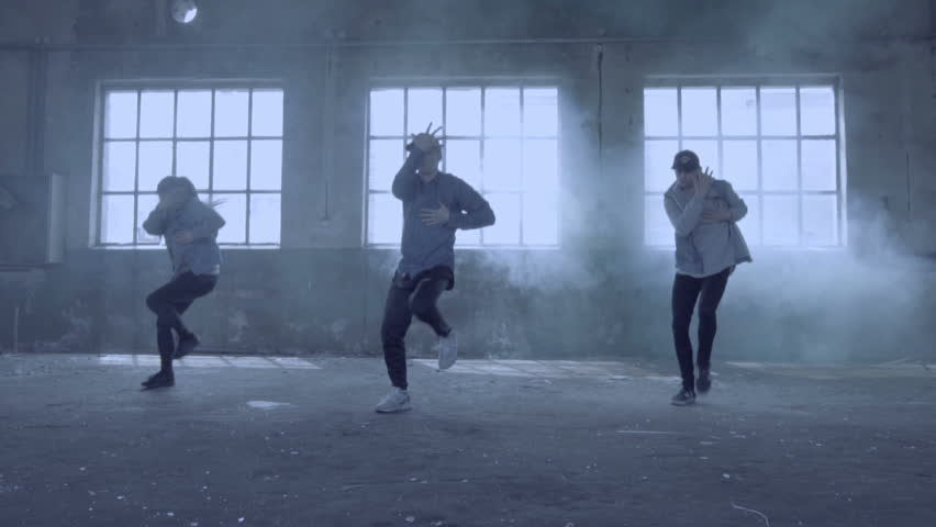 Video of active young group dancing choreography in an abandoned building with smoky background. | Shutterstock HD Video #17395486