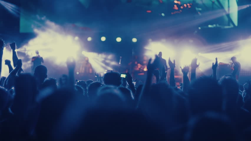Iconic night rock concert front row crowd cheering hands in air slomo 100p.Night rock concert.People cheer move lift and clap their hands in unison against the strobing stage lights. | Shutterstock Video #17430772