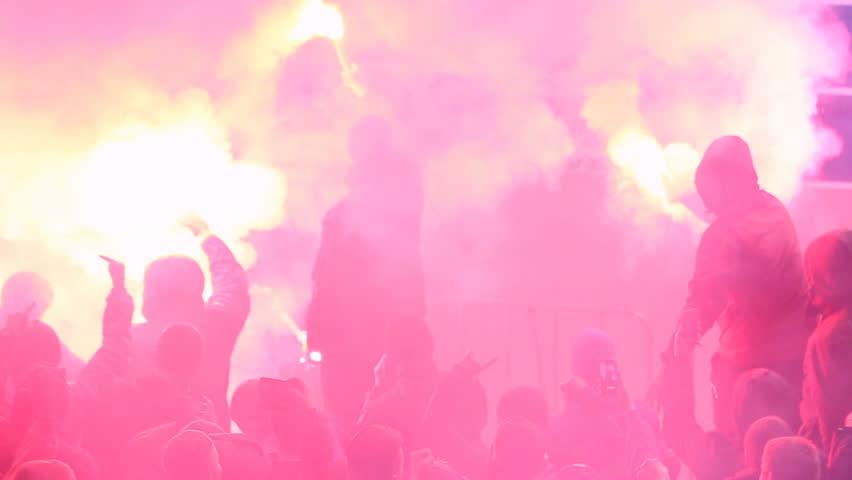 Hooligans using burning flares, smoke bombs at tribunes during football game