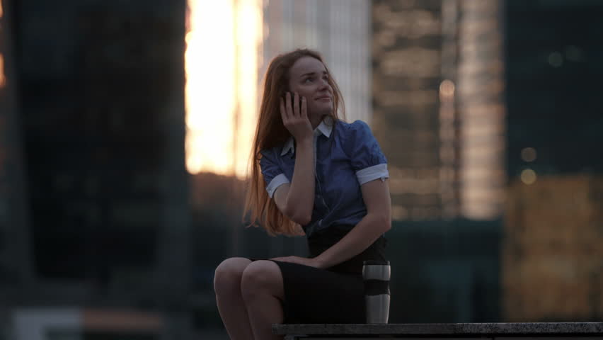 Young happy talking on cellphone in the city | Shutterstock HD Video #17624062