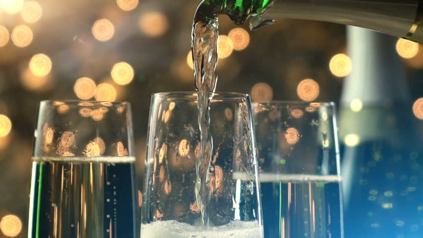 Champagne slow motion pour with Christmas lights and lens flare. | Shutterstock HD Video #17713936