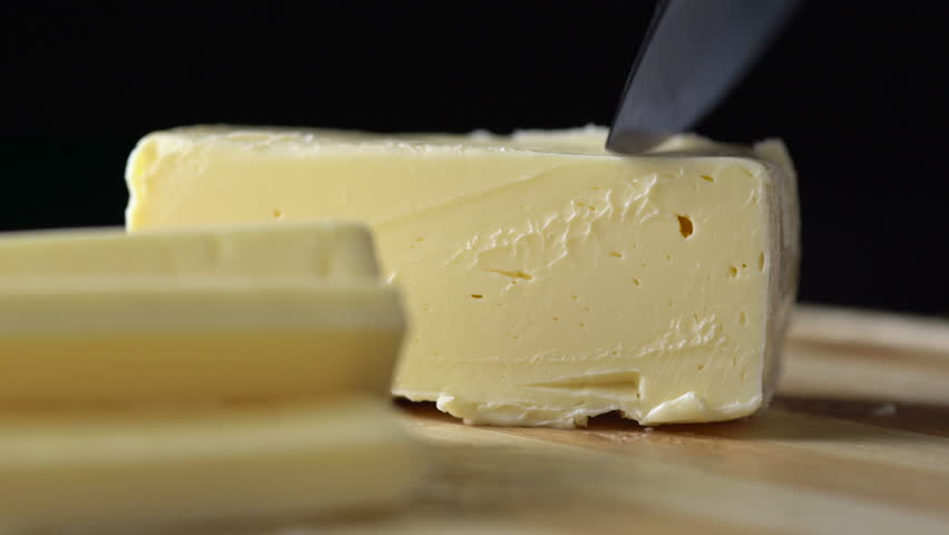 Sliced pieces of butter on wooden background #17769016