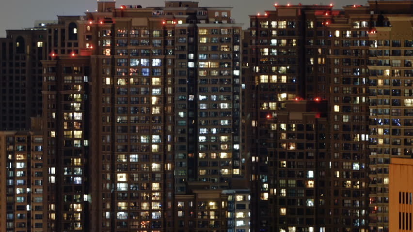 Time lapse of apartment building at night. Timelapse of residential flats windows lighting up and turning off overnight in Shanghai, China. Countless people live in massive building. | Shutterstock HD Video #17800609