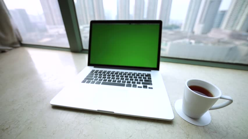 Pretty workspace with laptop, morning cup of coffee and amazing view of skyscrapers from the high window. Hong Kong, China. | Shutterstock HD Video #17837029