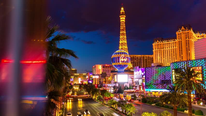 Night twilight las vegas famous paris casino hotel strip panorama 4k time lapse usa   Shutterstock HD Video #17844988