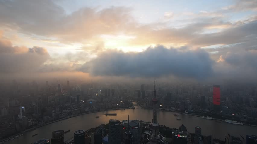 SHANGHAI, CHINA - JULY 7, 2016: Shanghai Skyline at Sunset over Oriental Pearl Tower and Huangpu River.  | Shutterstock HD Video #17872828