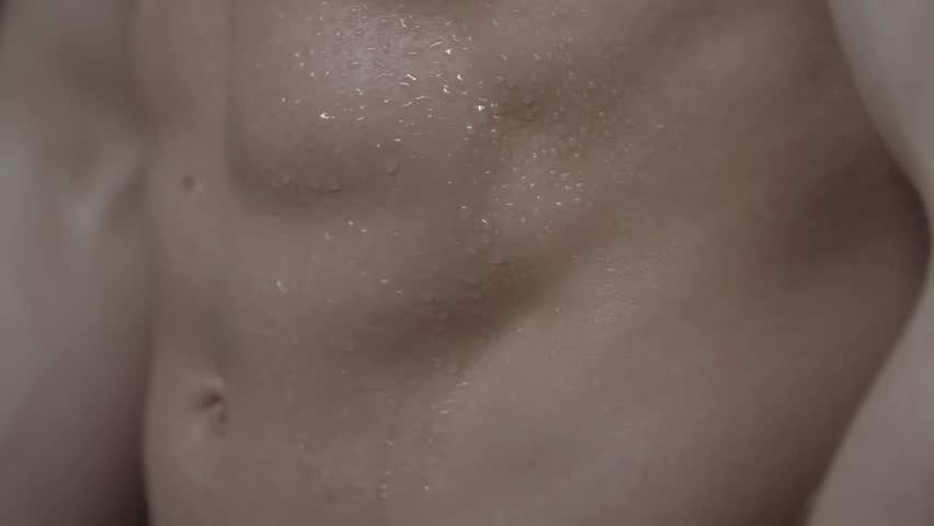 Close up of great male abs with sweating skin