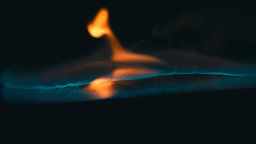 A lit match ignites gasoline. Blue wave at the forefront of fire go to meet. S-log - High Dynamic Range. Slow motion, high speed camera, 250fps