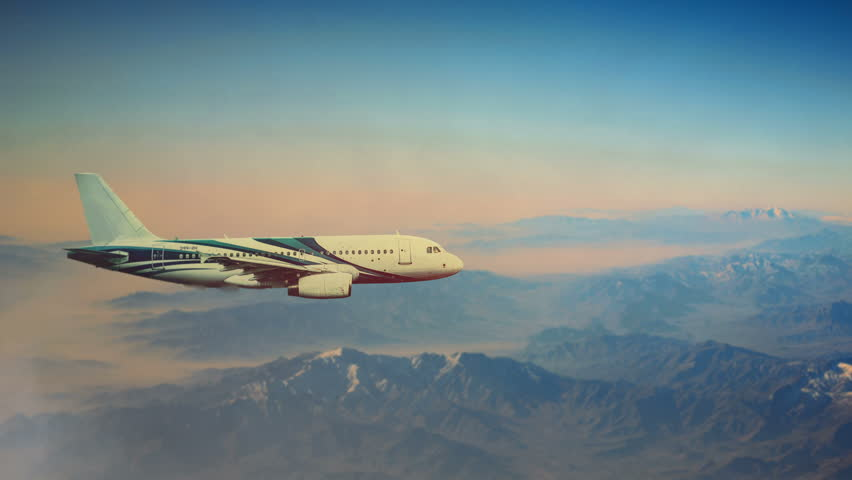 Cinematic style animation of the plane. Jet is flying above mountains.