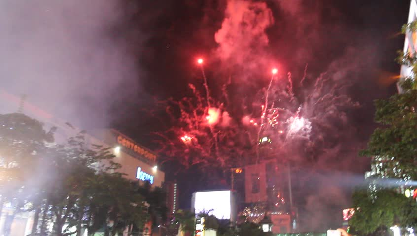 BANGKOK, THAILAND - DECEMBER 31: Fireworks for New Year celebrations taking place at Central World Plaza Countdown 2012, central Bangkok, On December 31, 2011 in Bangkok, Thailand.