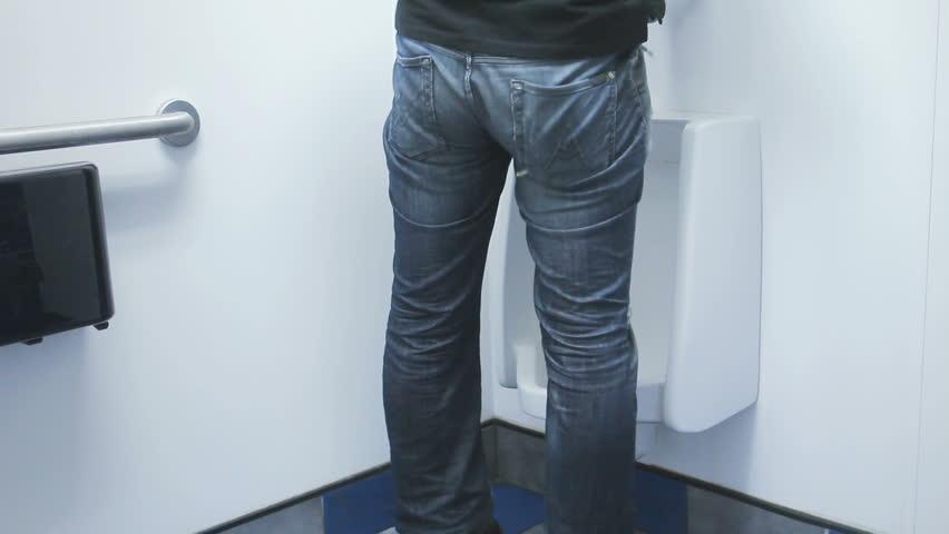 Man Pee On The Toilet Stock Footage Video 5052371
