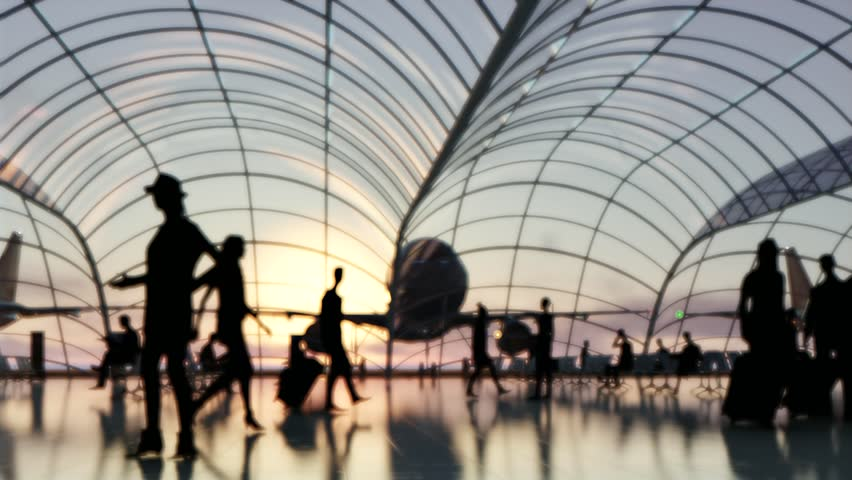Silhouette blurred people walk in a passenger terminal Curved glass at sunset