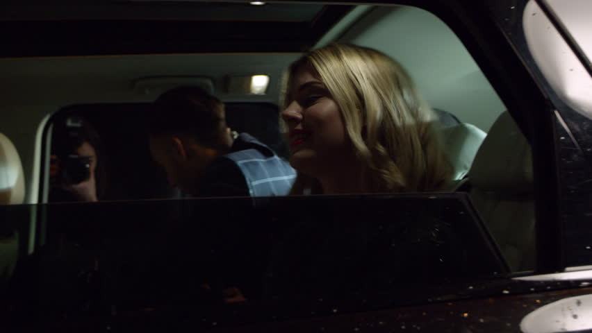 Celebrity couple get out of limo, photographed by paparazzi, shot on R3D #18295258