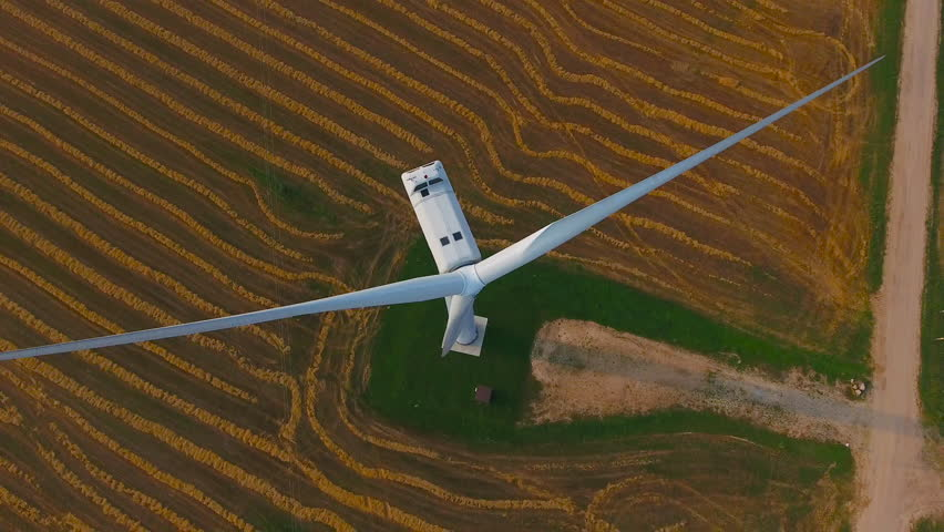 Aerial View. Beautiful windmill turbines , wind energy turbines . Aerial drone shot. 4K 30fps